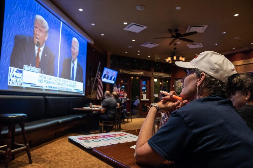 Voter Rhonda Marquardt watches the final presidential debate between President Donald Trump and former Vice President Joe Biden on October 22, 2020 in San Antonio, Texas.