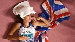 Trophy pose: Katarina Johnson-Thompson ponders her achievements after winning the world heptathlon title for the first time.