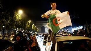Algeria fans celebrate in front of the Arc de Triomphe in Paris after winning the Africa Cup of Nations, 29 July 2019.