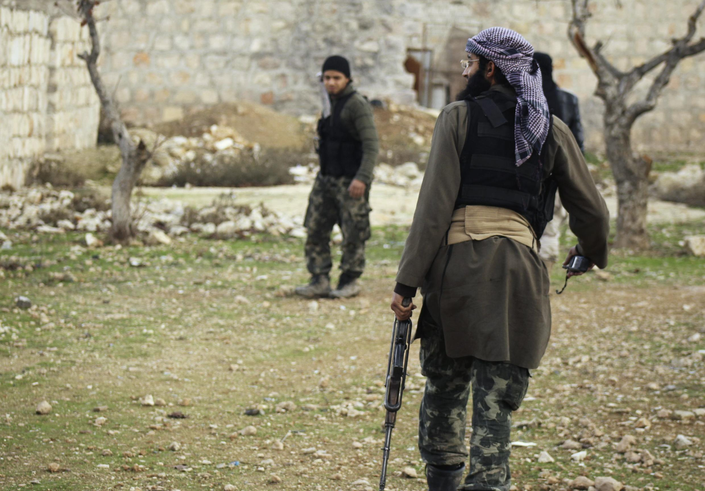Islamist al-Nusra fighters outside Aleppo airport