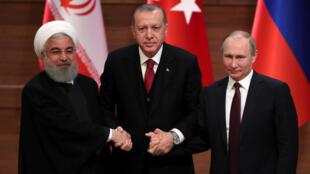 Recep Tayyip Erdogan (Turquia), Vladimir Putin (Rússia) e Hassan Rohani (Irã), reuniram-se para tentar avançar numa solução para a guerra que a arrasa a Síria, em 4 de abril de 2018.
