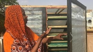 Awatif Baroud, Chadian entrepreneur, showing off her food dryer in N'Djamena