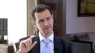 Syrian President Bashar al-Assad speaks during a TV interview