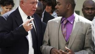 Roy Bennett and Nelson Chamisa, MDC spokesman, outside the Supreme Court in Harare