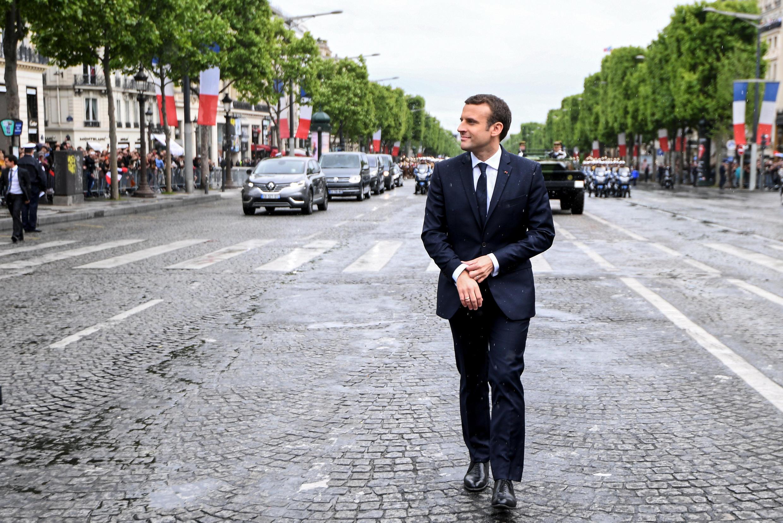 Президент Франции Эмманюэль Макрон на Елисейских полях, Париж, 14 мая 2014 г.
