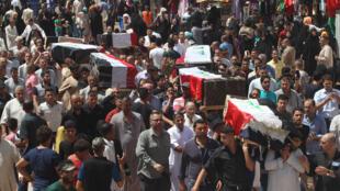 مراسم تشییع جنازه قربانیان انفجار بلد در  روز هشتم ژوئیه 2016.