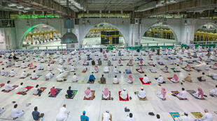 Worshippers pray at the Grand Mosque in the holy city of Mecca on Sunday as coronavirus restrictions slowly ease