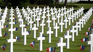 US and French flags are seen by tombs at the American cemetery in Colleville-sur-Mer on June 6, 2009 prior to D-Day celebrations to mark the 65th anniversary of the June 6, 1944 allied landings in Normandy.