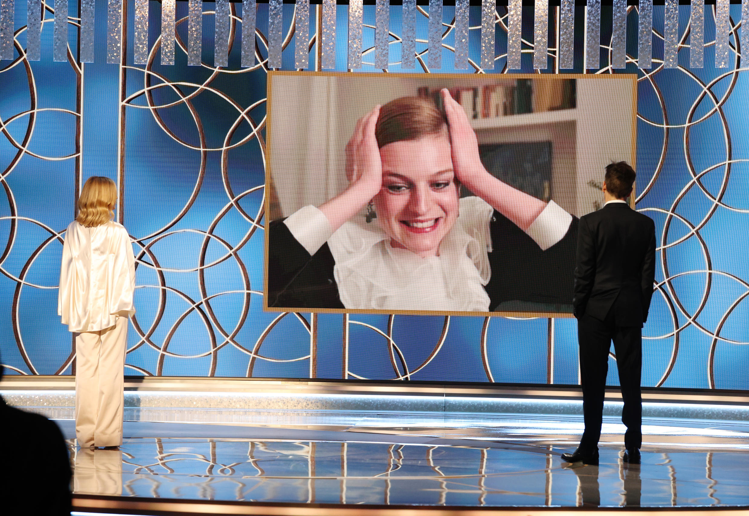 """Emma Corrin appears via video chat to accept the Golden Globe for best TV drama actress for her role as Princess Diana in """"The Crown"""""""