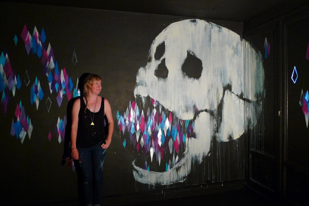 You talkin' to me? Vexta, a renowned street artist from Australia, chats to one of her skulls.