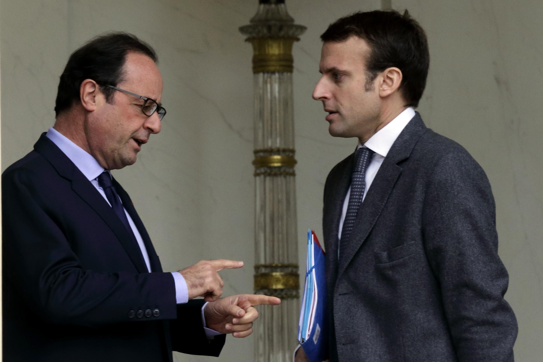 France's Economy Minister Emmanuel Macron (R) with President François Hollande