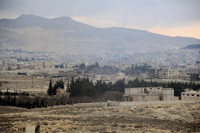 Vista de Yabrud coberta de fumaça pelos bombardeios do Exército sírio. Sábado, 15 de março de 2014.