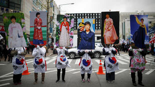 Supporters of ousted President Park Geun-hye gather outside a court after judges handed down a 24-year sentence, in Seoul, South Korea, April 6, 2018.