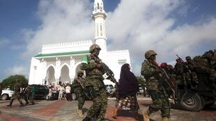 Amisom soldiers on patrol in front of a mosque in Mogadishu, the capital of Somalia.