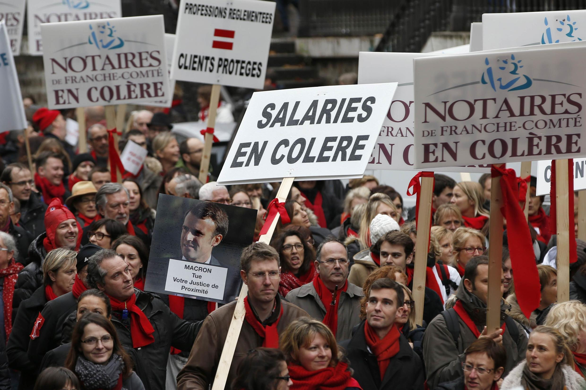 Lawyers, notaries and bailiffs protest in Paris as parliament prepares to discuss Emmanuel Macron's economy bill