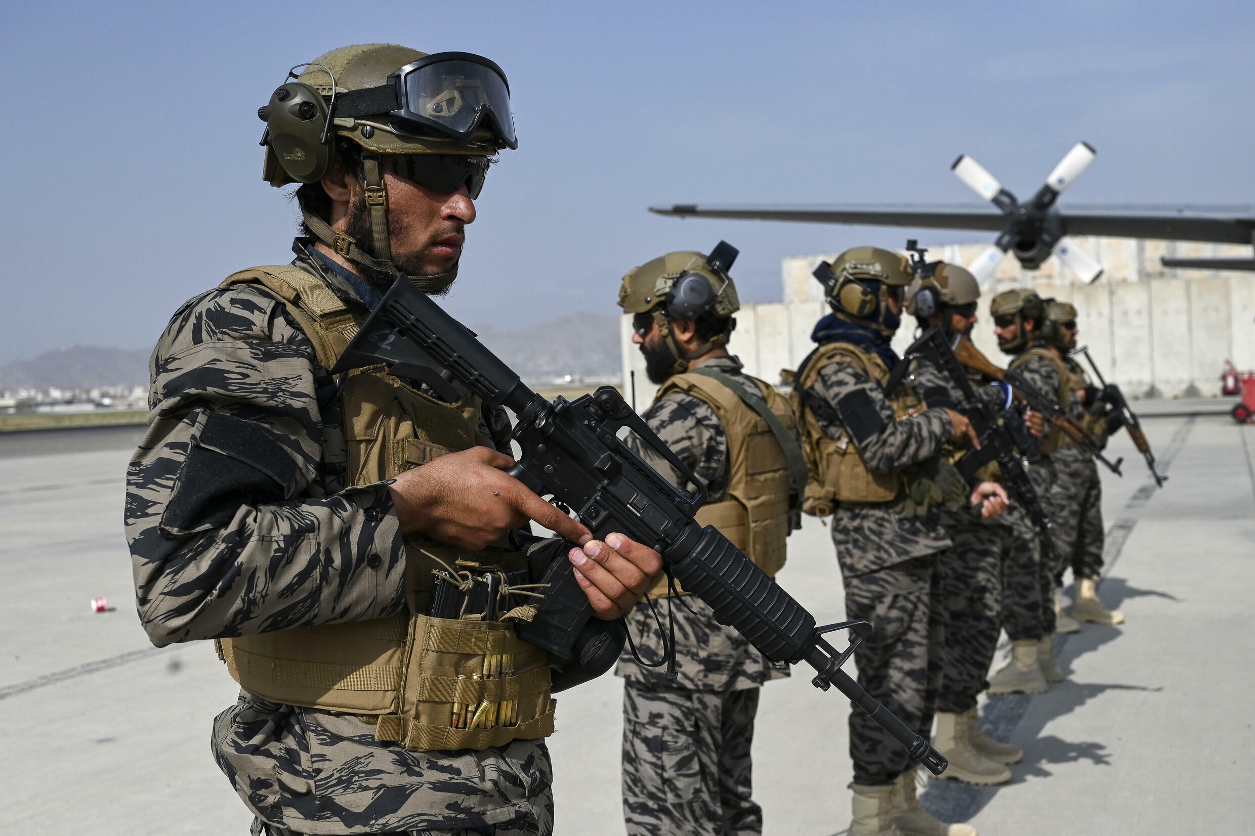 Taliban troops at Kabul's airport: Will China or Russia see the Taliban's seizure of power in Afghanistan as a sign of US weakness?