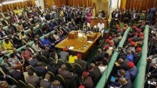 This general view shows Ugandan Parliament Speaker Rebecca Kadaga (C) as she presides over the plenary session at the Ugandan Parliament in Kampala on September 27, 2017.