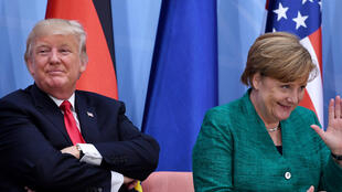 "Donald Trump (L) and German Chancellor Angela Merkel attend the panel discussion ""Launch Event Women's Entrepreneur Finance Init"