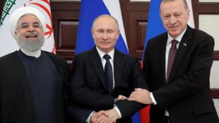 Les présidents Hassan Rohani, Vladimir Poutine et Recep Tayyip Erdogan à Sotchi, le 14 février 2019.