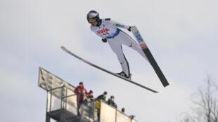 Record breaker: Japan's Ryoyu Kobayashi soars through the air at the World Cup event in Rasnov, Romania