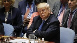Le président américain Donald Trump écoute lors d'une réunion du Conseil de sécurité de l'ONU, le 26 septembre 2018 à New York.