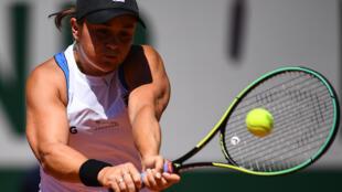 Power-packed: Australia's Ashleigh Barty returns the ball to Bernarda Pera