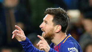 Lionel Messi scored twice in Barcelona's 5-1 rout of Lyon.