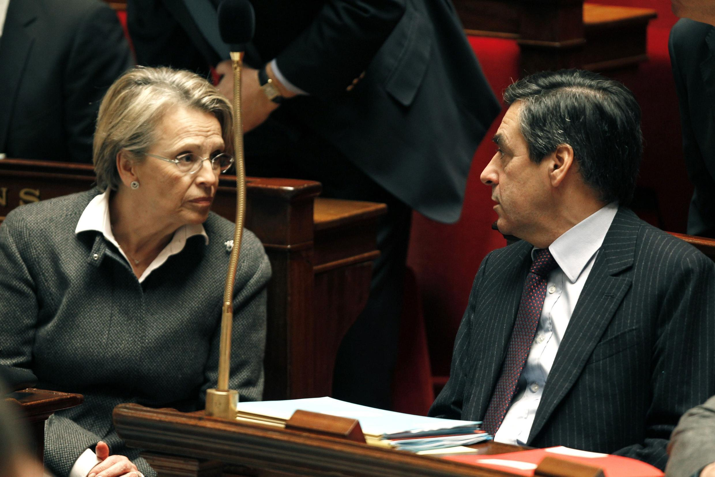 Prime Minister Francois Fillon (R) and Foreign Minister Michèle Alliot-Marie at the National Assembly in Paris, 15 February