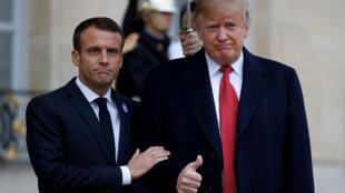 Tổng thống Pháp Emmanuel Macron đón tổng thống Mỹ Donald Trump tại điện Elysée, ngày 10/11/2018.