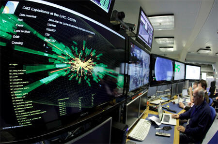 Screens show particle collisions in the control room of the Large Hadron Collider near Geneva in Switzerland
