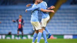 Manchester City's John Stones and Ruben Dias celebrate