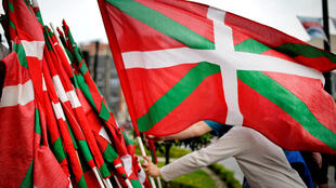 A man holds a Basque flag at a demonstration supporting Eta prisoners held in Bilbao, 21 April 2018.
