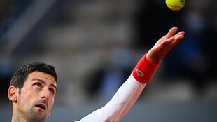 Top seed Novak Djokovic advanced to the last four of the French Open with a four set win over Spain's Pablo Carreno Busta.