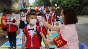 2020-05-12T041549Z_1286371707_RC2SMG9TU6GK_RTRMADP_3_HEALTH-CORONAVIRUS-CHINA
