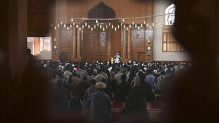 Muslim devotees offer prayers to start the Eid-al-Fitr festival at a mosque in Kabul
