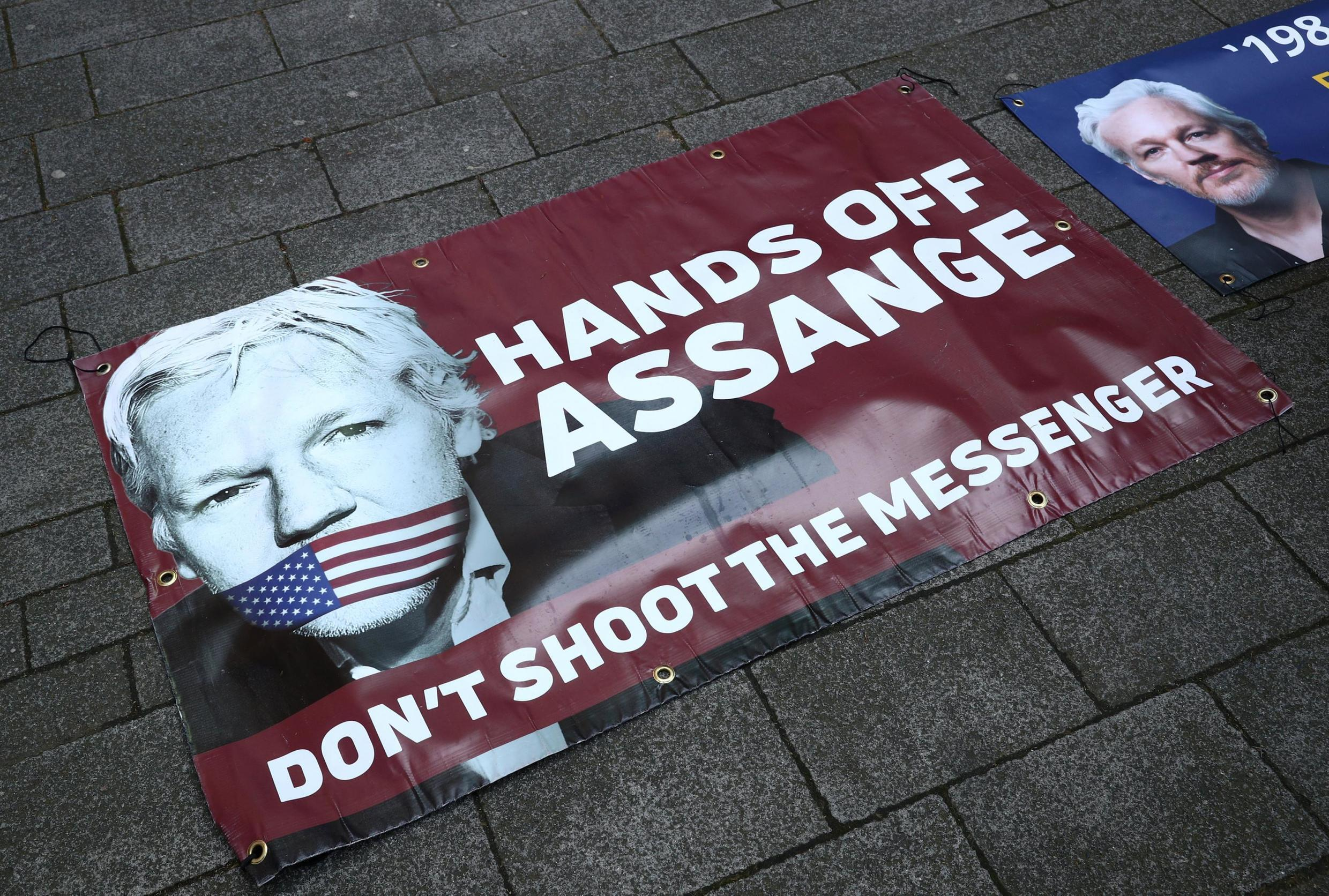 A poster of support for Julian Assange outside the court in Westminster, London, 11 April, 2019.