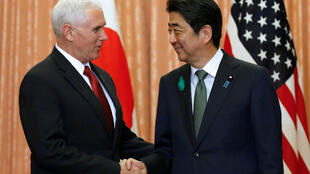 U.S. Vice President Mike Pence (L) is welcomed by Japan's Prime Minister Shinzo Abe at their meeting at Abe's official residence in Tokyo, Japan, April 18, 2017.