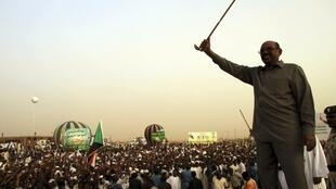 President Omar al-Bashir addresses a crowd in Khartoum, 8 June, 2013