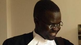Nicholas Opiyo appears with anti-gay pastor Martin Ssempa at the constitutional court hearing in Kampala, 30 July 2014.