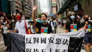 2020-07-01T161211Z_1641382234_RC2GKH9NZ2SZ_RTRMADP_3_HONGKONG-PROTESTS-ANNIVERSARY