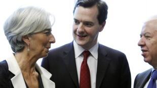 Bộ trưởng Tài chính Anh George Osborne (phải) và đồng nhiệm Pháp C.Lagarde (REUTERS)