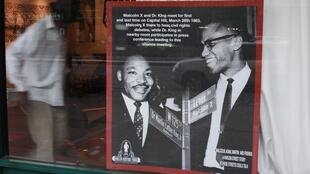 Malcolm X and Martin Luther King pictured in the window of Harlem Heritage Tours