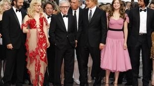 Director Woody Allen arrives with cast members for the screening of Midnight In Paris.