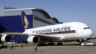 Hai hãng hàng không dân sự trong khối ASEAN là Singapore Airlines và Thai Airways cho biết tuân thủ yêu cầu của Trung Quốc - AFP
