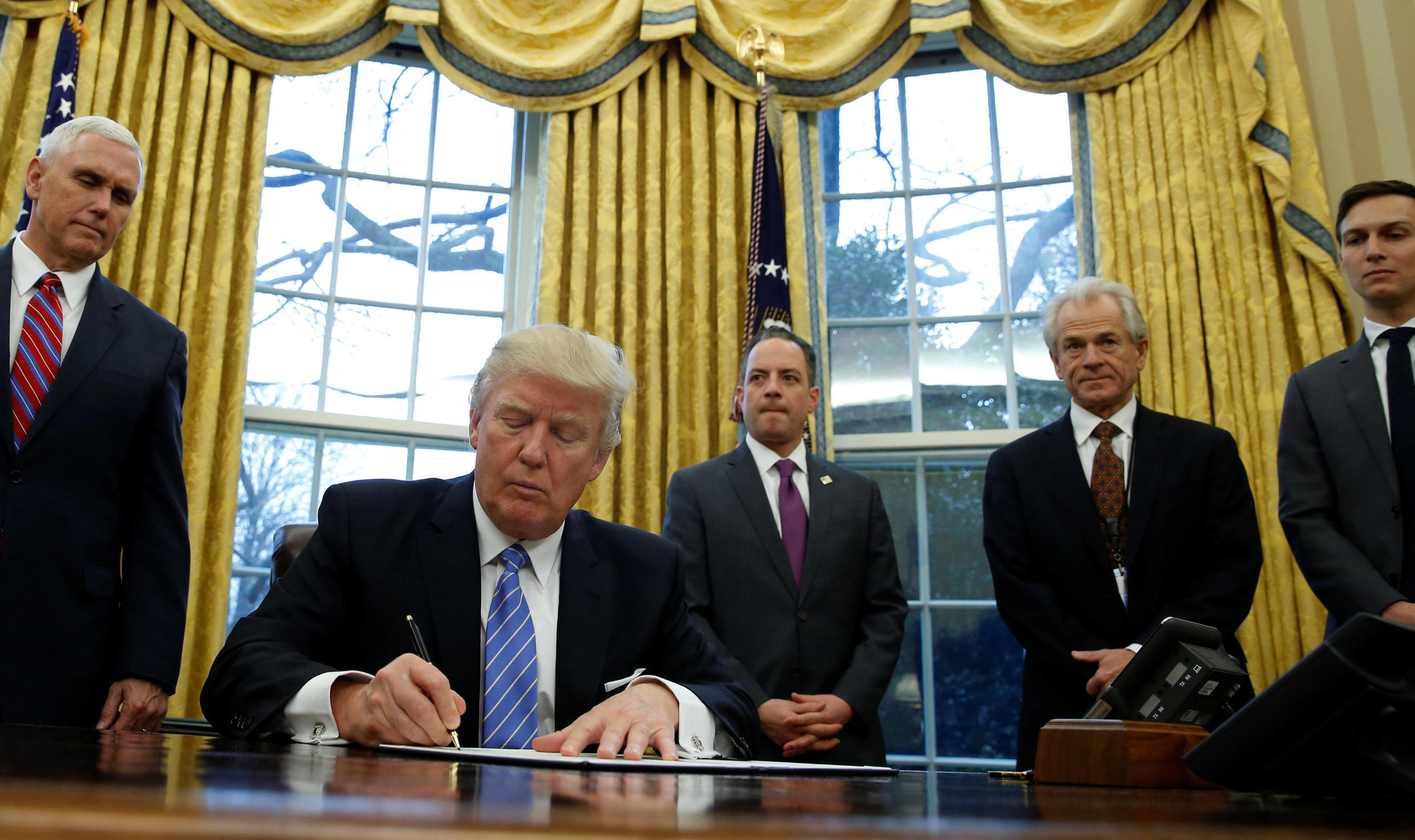 U.S. President Donald Trump with (L-R) Vice President Mike Pence, White House Chief of Staff Reince Priebus, head of the White House Trade Council Peter Navarro and senior advisor Jared Kushner.