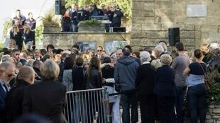 People attend the funerals of Mauranne and Laura, two 20-year-old cousins stabbed on October 1, 2017 outside Saint-Charles train station in the coastal city of Marseille at the church of Eguilles, southern France, on October 5, 2017.