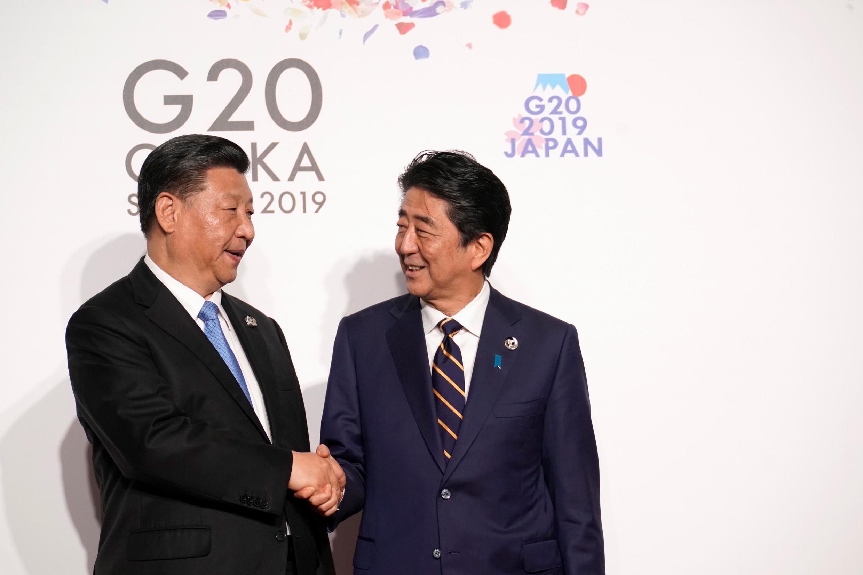 2019年6月28日,日本首相安倍晉三迎接前來參加大阪20國集團領導人峰會的中國國家主席習近平。