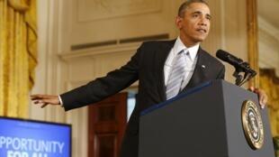 Barack Obama s'exprime sur son choix d'augmenter le salaire minimum des travailleurs sous contrat fédéral à la Maison Blanche à Washington, le 12 Février 2014.