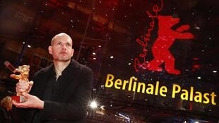 Nadav Lapid poses with Golden Bear for Best Film after the awards ceremony at the 69th Berlinale International Film Festival in Berlin, Germany, February 16, 2019.