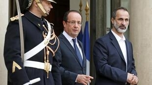 French President François Hollande leaves the Elysée with National Coalition leader Ahmed Moaz al-Khatib